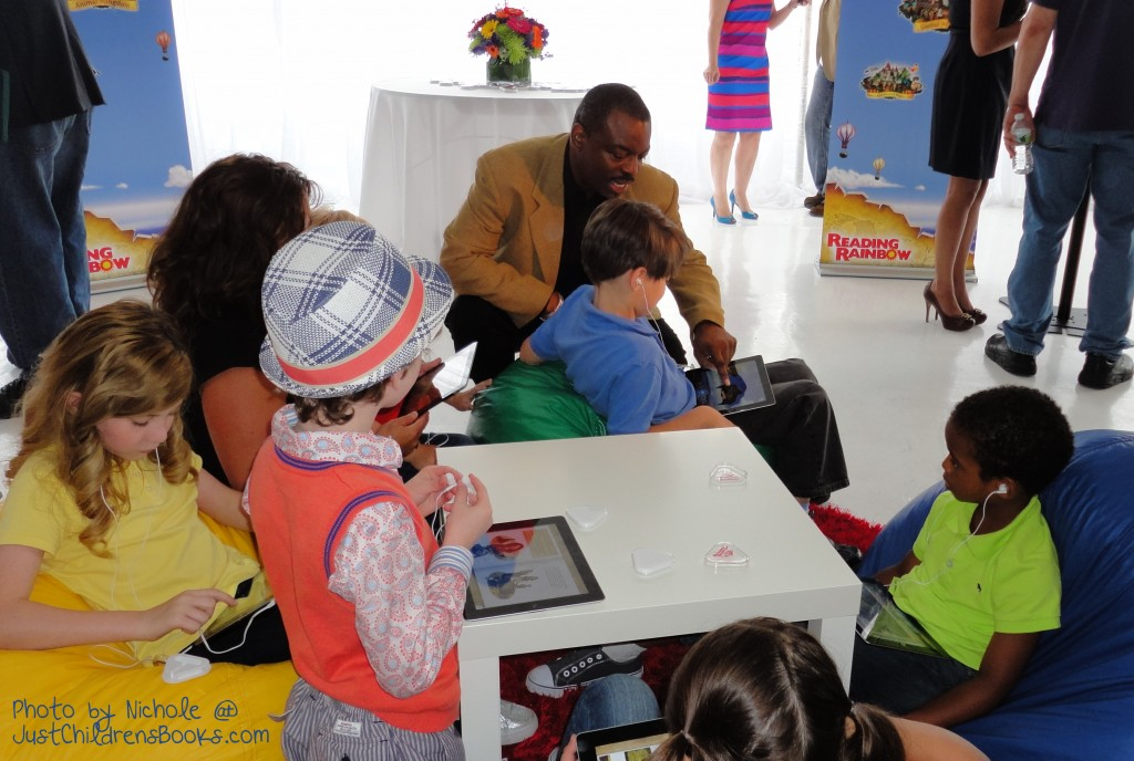 LeVar Burton showing kids the Reading Rainbow App